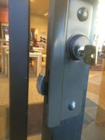 Aluminum Store Front Latch Guard Showing Bolt Protection