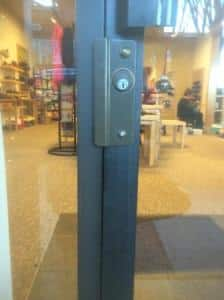 aluminum store front latch guard